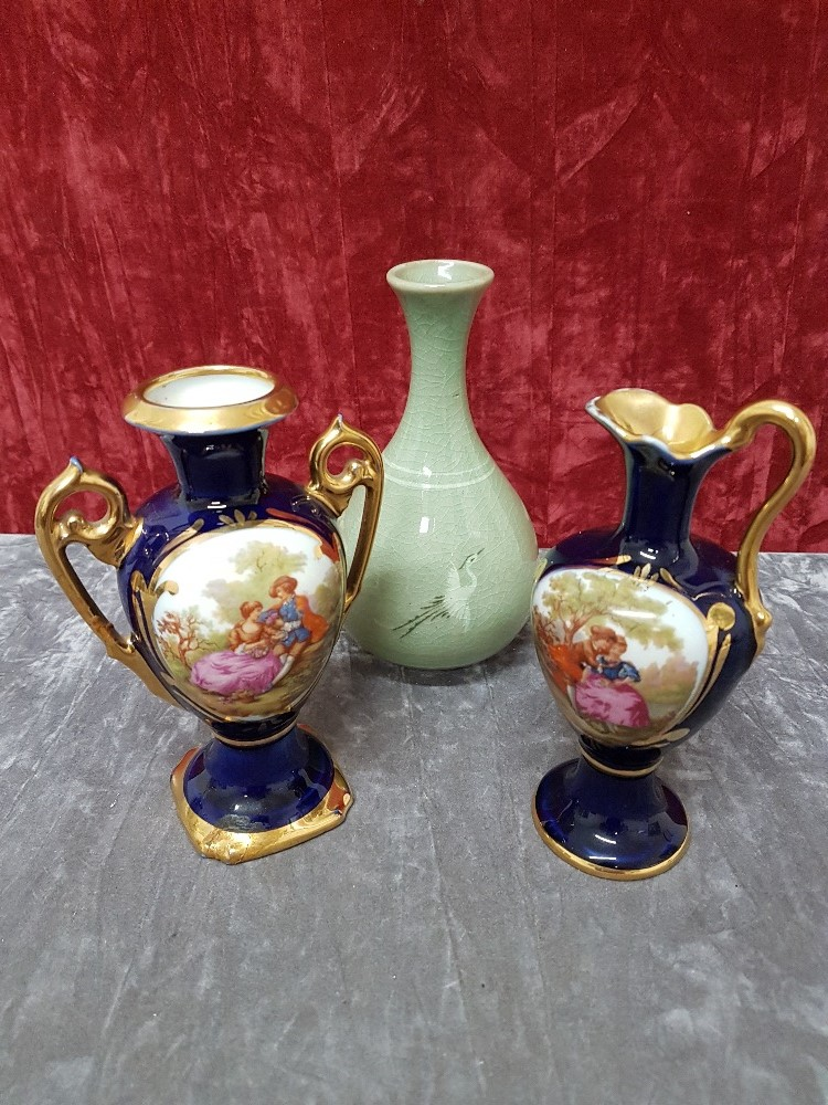 Lot 35 - Two Limoges vases plus another green glazed vase.