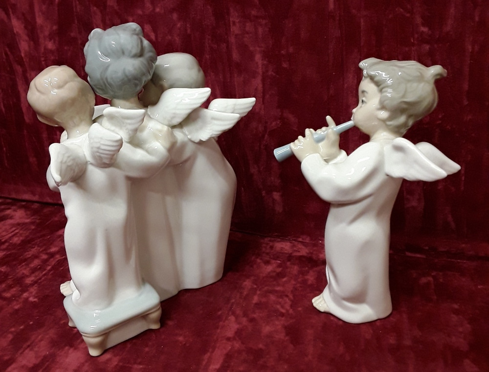 Lot 20 - A pair of Lladro figurines in the form of cherubs.