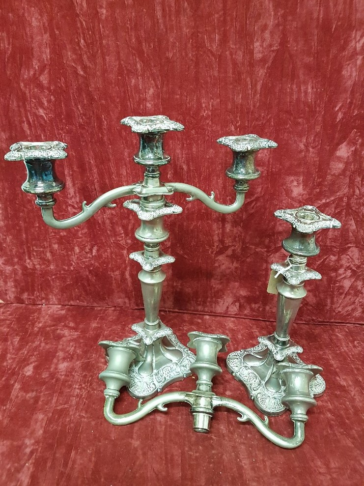 Lot 371 - A pair of decorative silver plated candelabra.