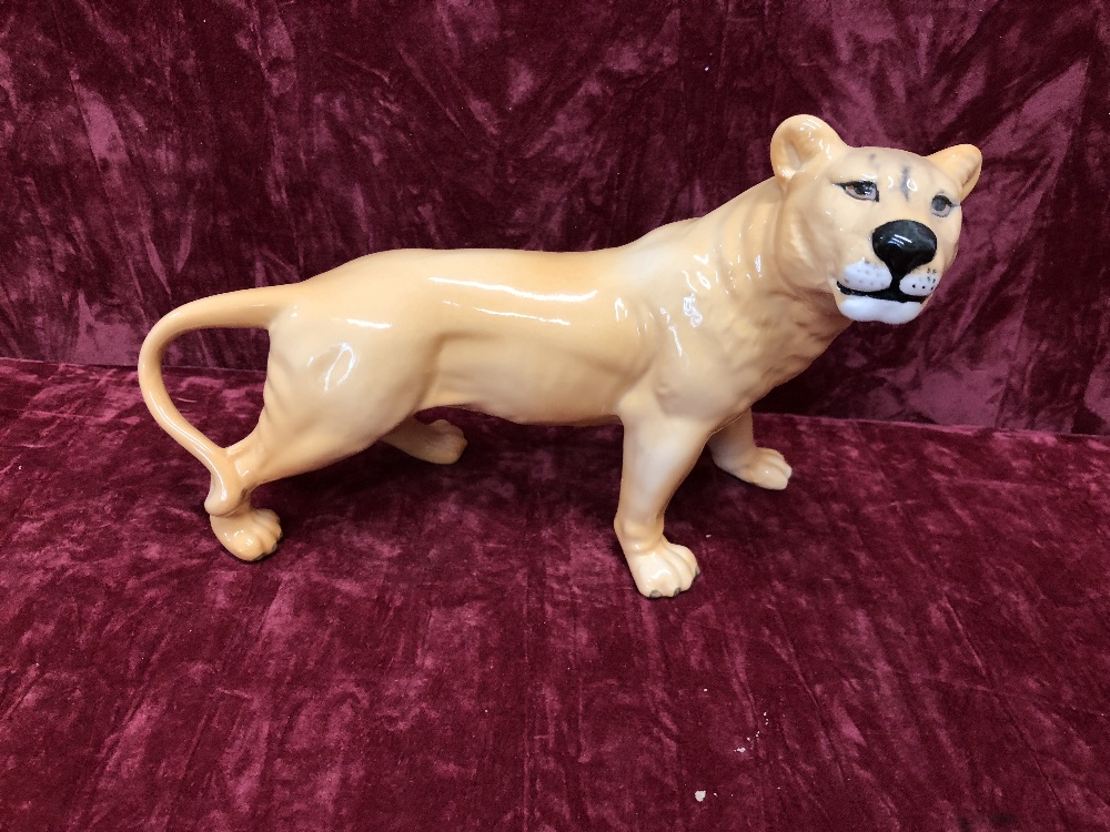 Lot 37 - A Beswick lion and lion cub, and two lionesses (2098 and 1507).
