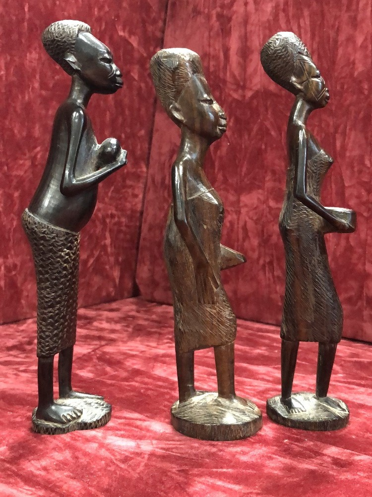Lot 50 - A group of three African carved wooden tribal figures