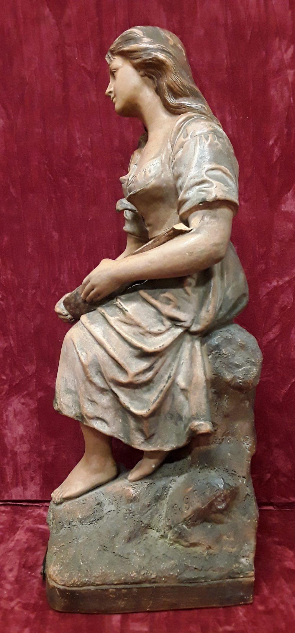 Lot 6 - A tall Mignon figurine in terracotta.