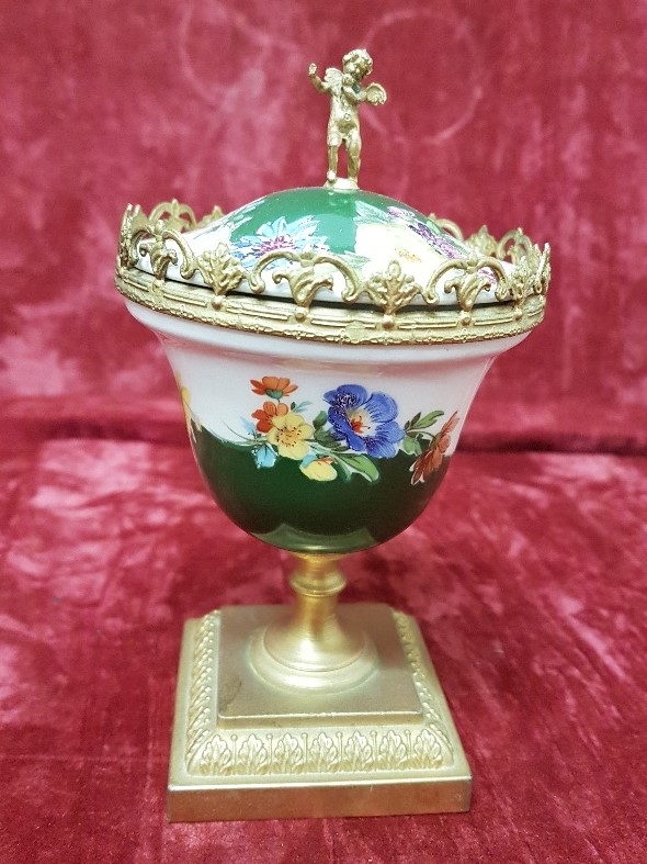 Lot 14 - A beautifully painted ceramic urn with lid mounted on a brass plinth.