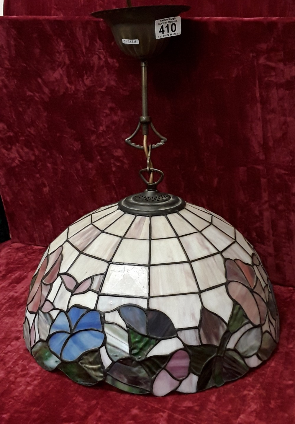 Lot 410 - A vintage Tiffany style lamp shade and fittings of with blue, pink and green flowers.