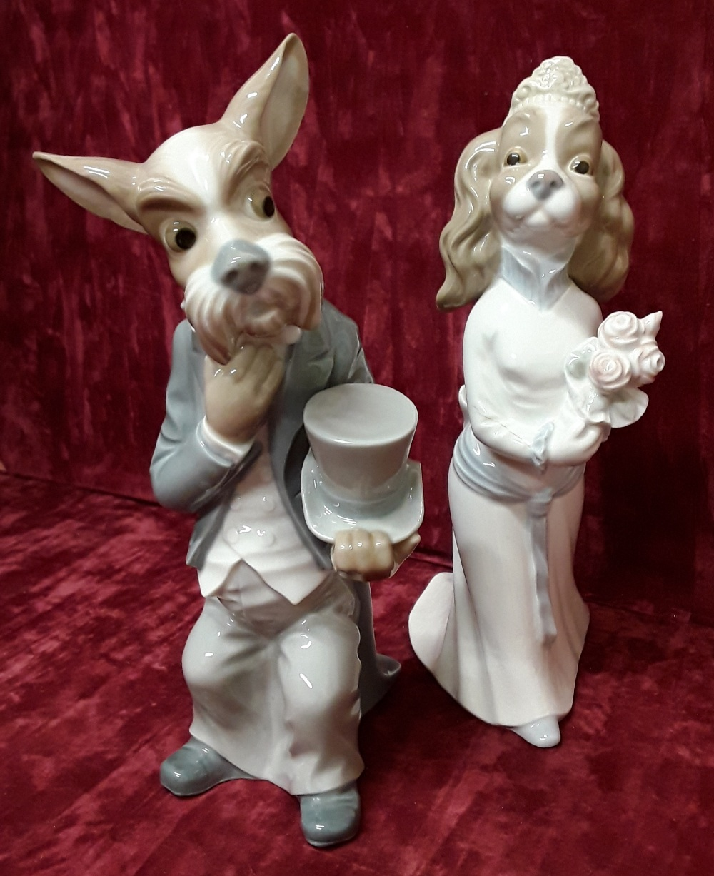 Lot 32 - A pair of Nao figurines showing dogs as bride and groom.