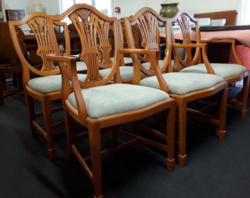 Lot 487 - A contemporary yew extending dining table with four chairs and two carvers.