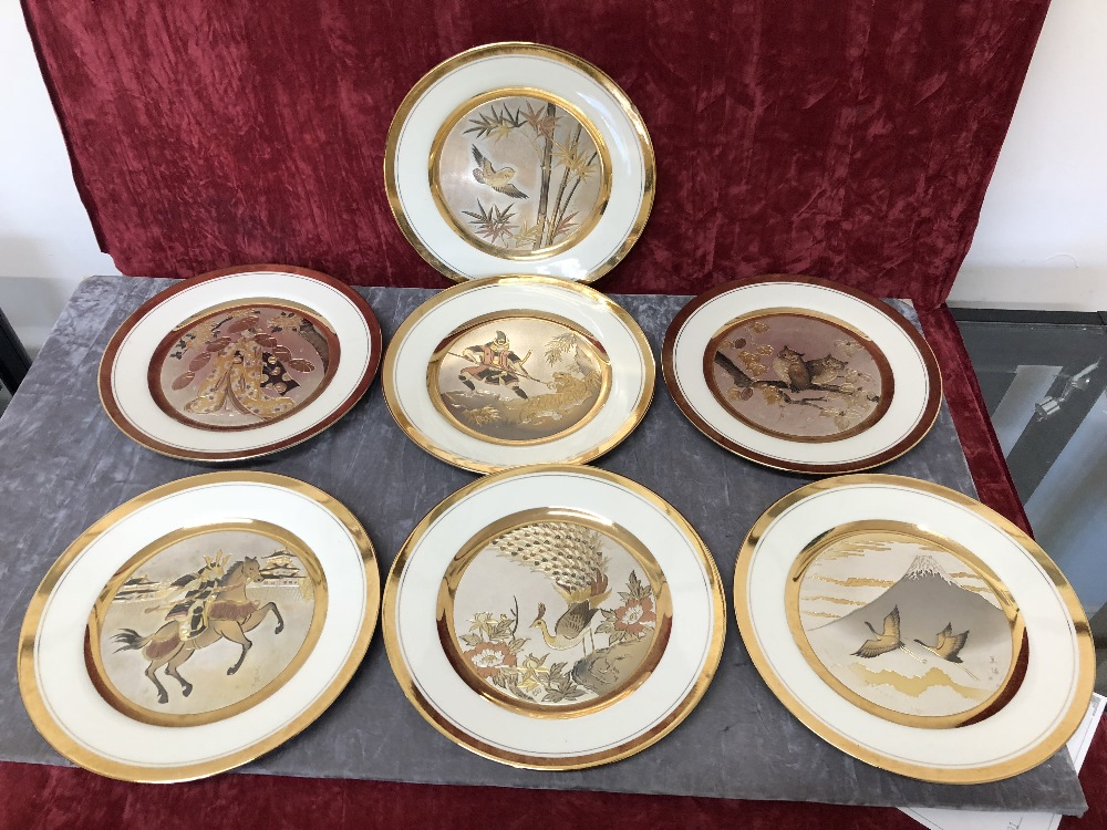 Lot 34 - A set of seven Chokin collector's plates depicting Japanese scenes.