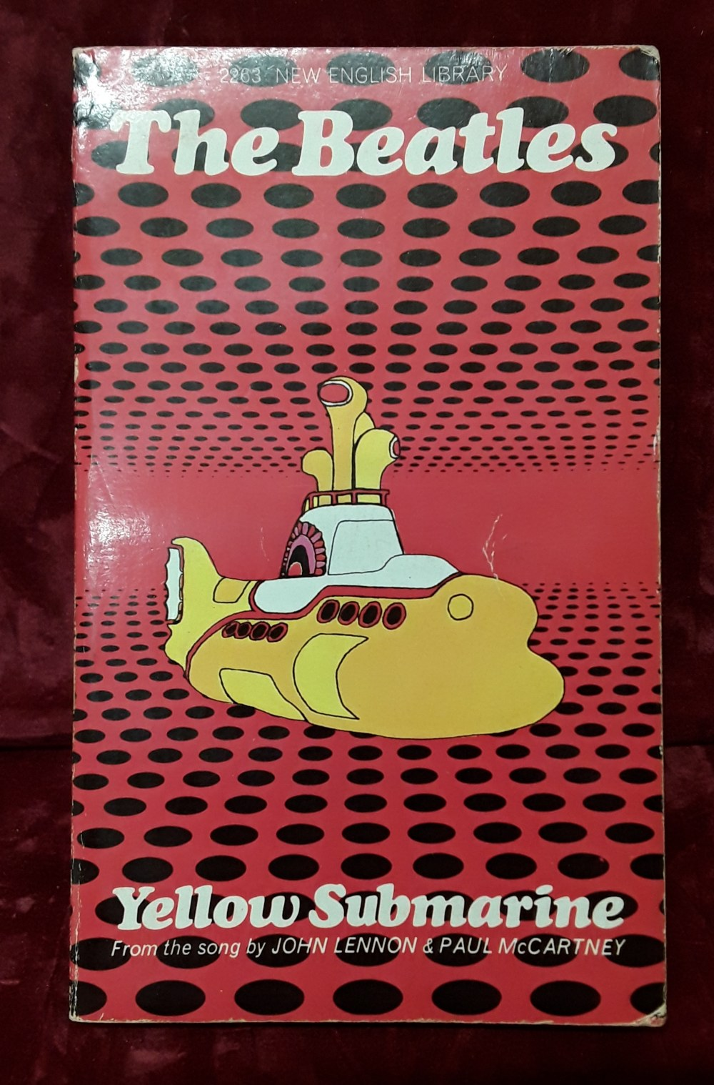 """Lot 422 - A first edition copy of the """"The Beatles Yellow Submarine"""" paperback book."""