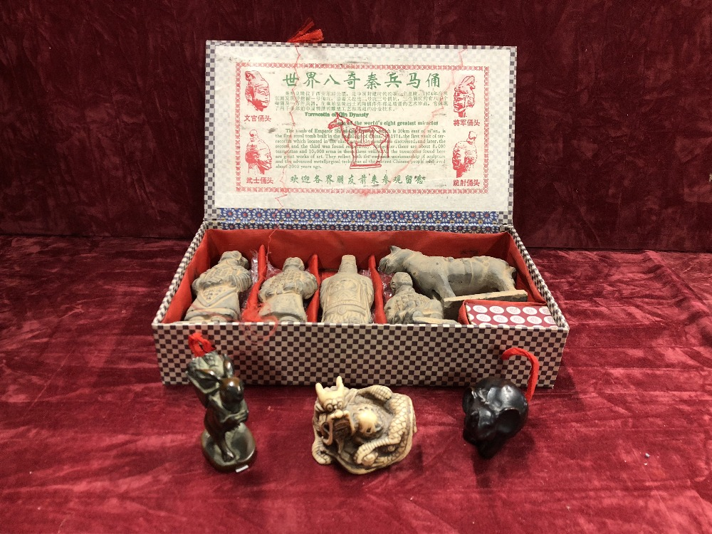 Lot 36 - A souvenir box of miniature terracotta figures plus three miniature figures.