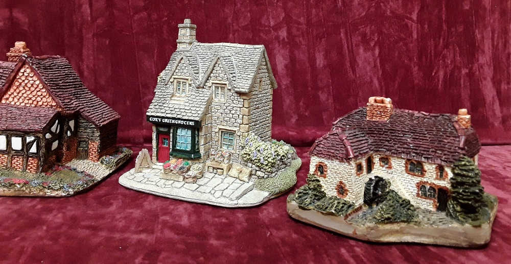 Lot 29 - A collection of six Lilliput Lane buildings including two early and two signed.