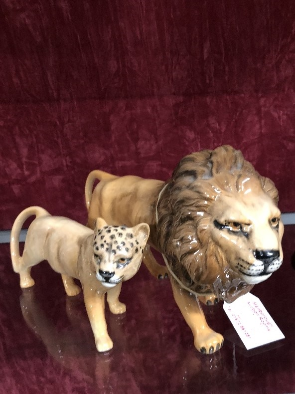 Lot 31 - A Beswick lion and lioness.