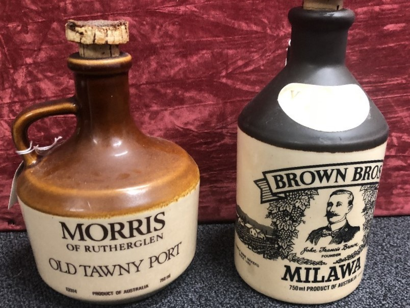 Lot 54 - A pair of vintage ceramic Australian bottles with corks.