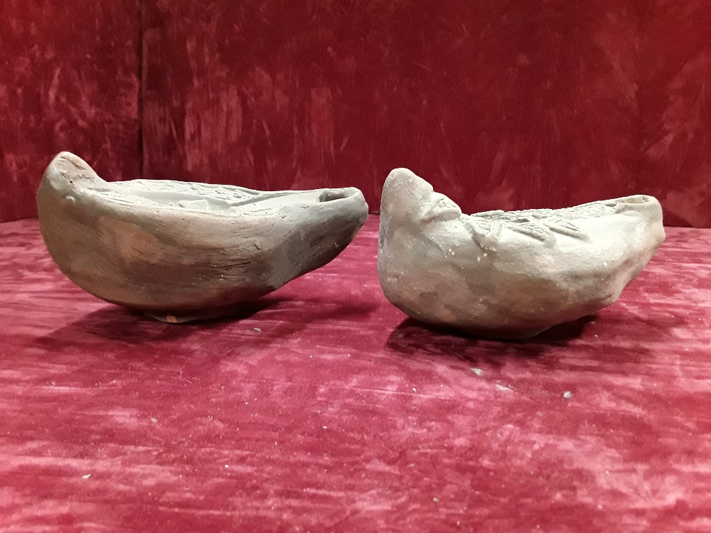 Lot 55 - Two clay reproduction decorative Roman oil lamps.