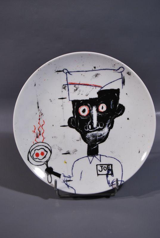 Lot 46 - Jean-Michel BASQUIAT - D'après - Eyes & Eggs - Assiette en porcelaine - D. 21 cm - [...]