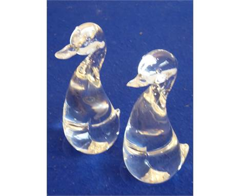 A pair of clear glass models of standing ducks, each signed Steuben (American Art Glass Manufacturer), to the underside, 19.5