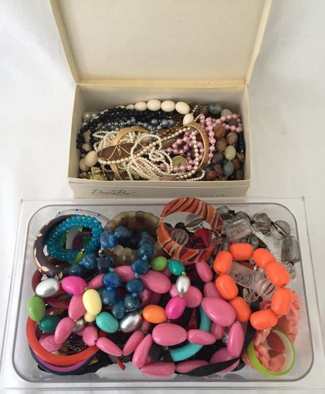 Lot 1014 - 2 boxes full of costume jewellery.