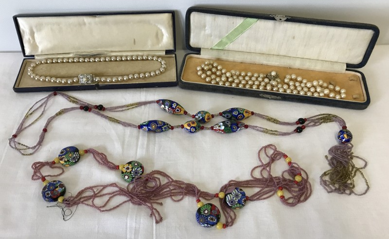 Lot 1023 - 2 long millefiori style bead and glass bead necklaces.