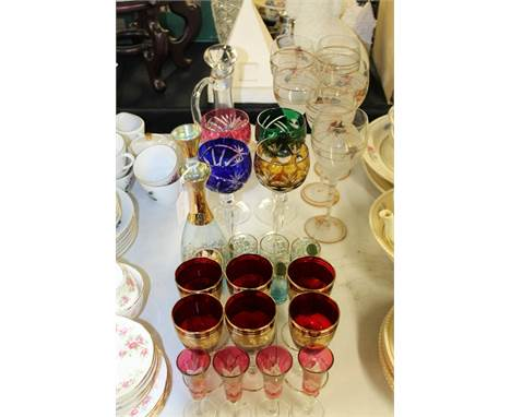 Glass ware, to include carafe and six glasses, four bohemian style wine glasses, six ruby and gilt decorated glasses, blue an