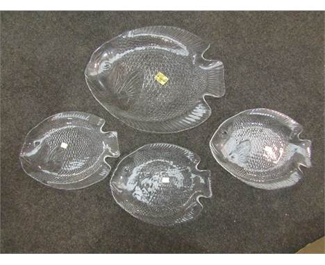 A French seven piece glass plate set with serving platter of fish form made by Arcoroc France, boxed and a studio art glass b