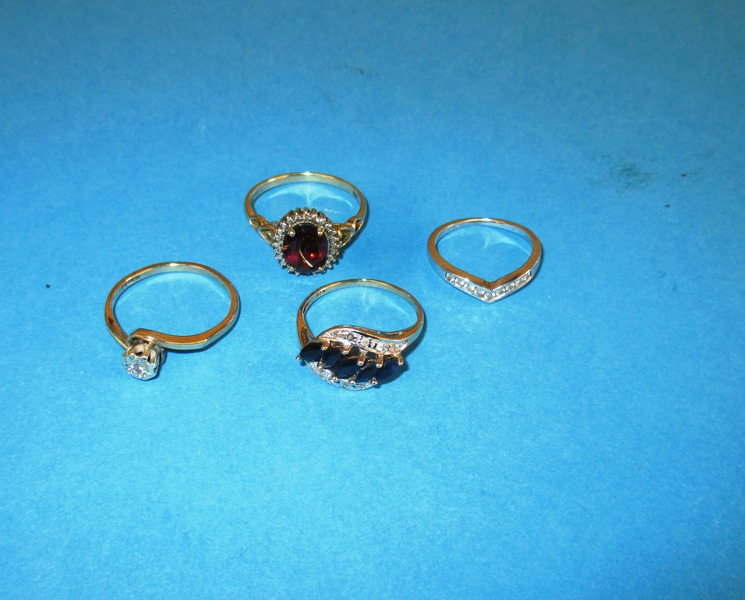 Lot 12 - Three 9ct gold rings and a 14ct example