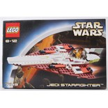 STAR WARS: An original Lego Star Wars Jedi Starfighter 7143 set.