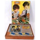 LEGO SYSTEM: An early vintage Lego System cased set of building bricks etc.
