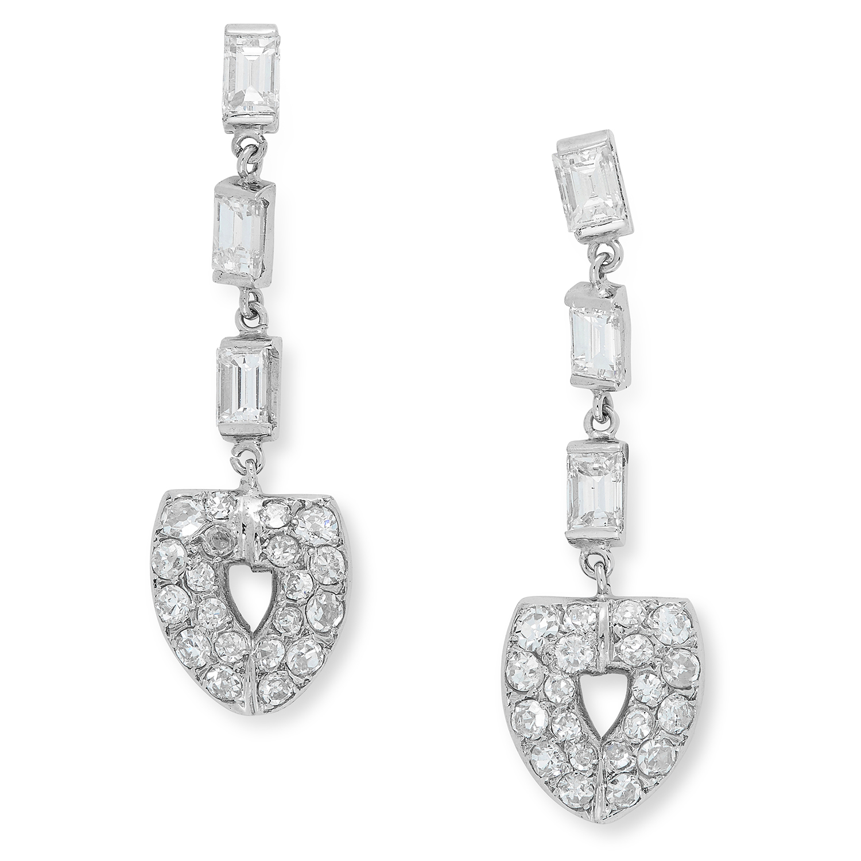 DIAMOND DROP EARRINGS each set with three baguette cut diamonds suspending round cut diamond drop,