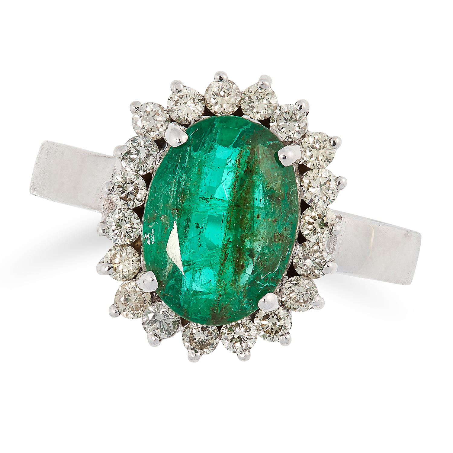 EMERALD AND DIAMOND CLUSTER RING set with an oval cut emerald in a cluster of round cut diamonds,