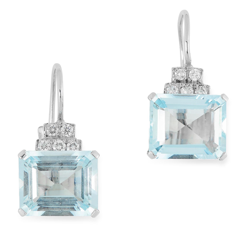 AQUAMARINE AND DIAMOND EARRINGS each set with round cut diamonds and an emerald cut aquamarine, 2.