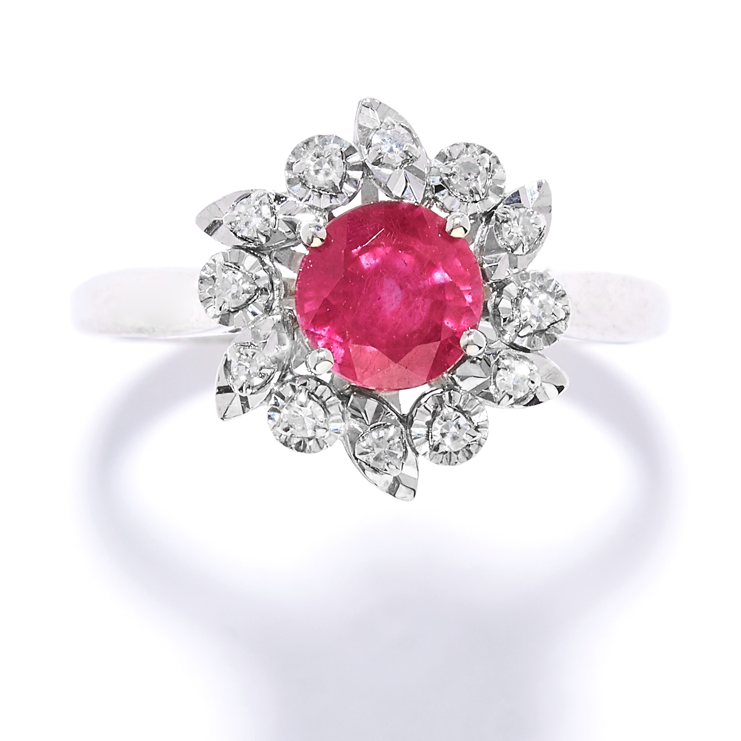 RUBY AND DIAMOND CLUSTER RING set with a round cut ruby in a cluster of round cut diamonds, size N /