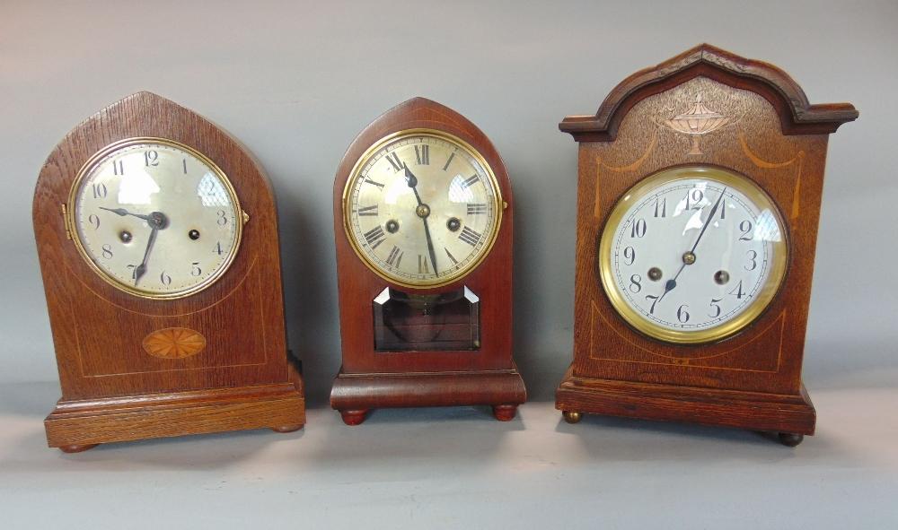 Three Edwardian two train lancet mantel clocks