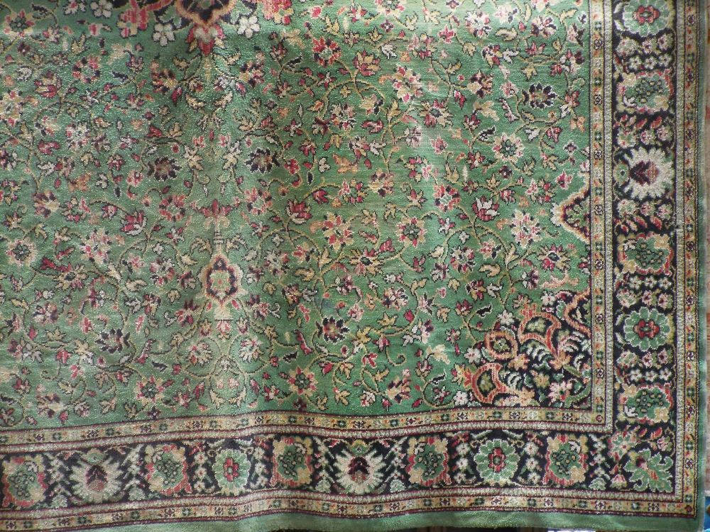 Lot 1435 - Keshan type carpet decorated with black floral sprays upon a green ground, 340 x 260 cm