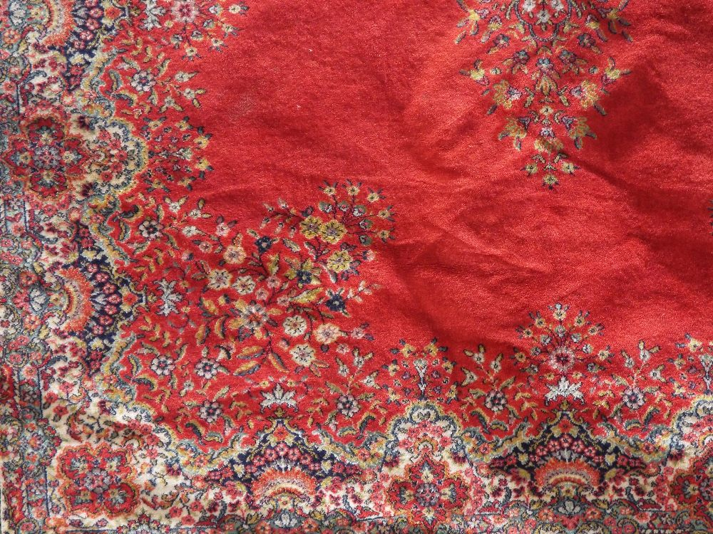 Axminster type carpet decorated with a central floral medallion upon a red ground, 280 x 200 cm - Image 2 of 2
