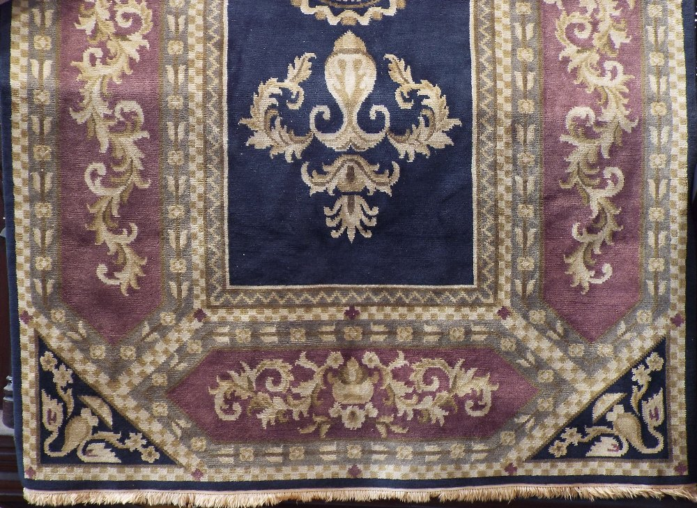 Lot 1418 - A Belgian type full pile carpet with classical scrolled acanthus stylings upon a black ground, 280 x