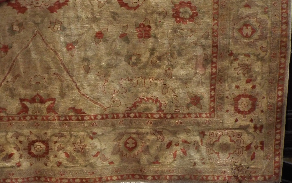 Large Caucasian country house carpet with typical red floral sprays upon an ivory ground, over 400