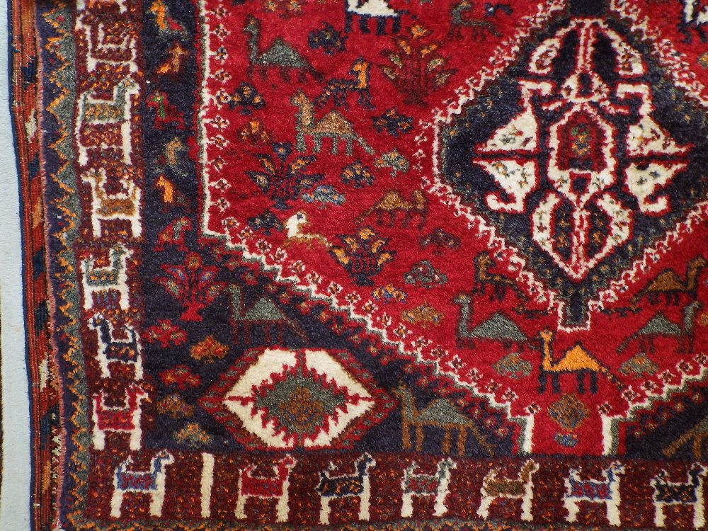Afghan full pile rug decorated with three central medallions, framed by animal symbols and foliage - Image 2 of 2
