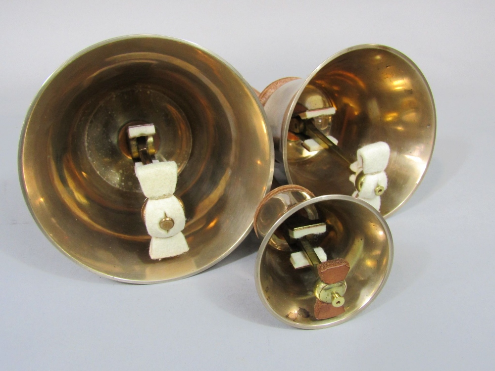 Lot 862 - A set of twenty two hand bells, fairly recently refurbished with new leathers, mufflers, etc