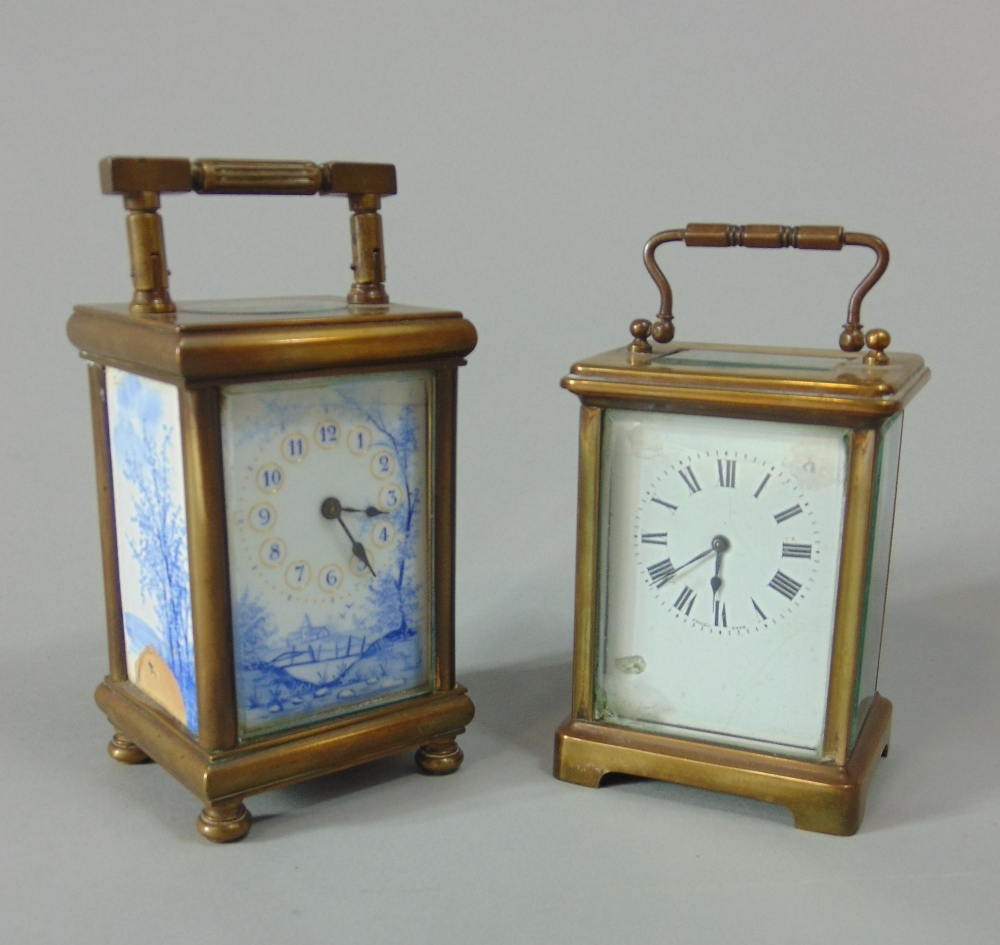 Lot 557 - Brass and enamel carriage timepiece the front and side panels with blue and white landscape