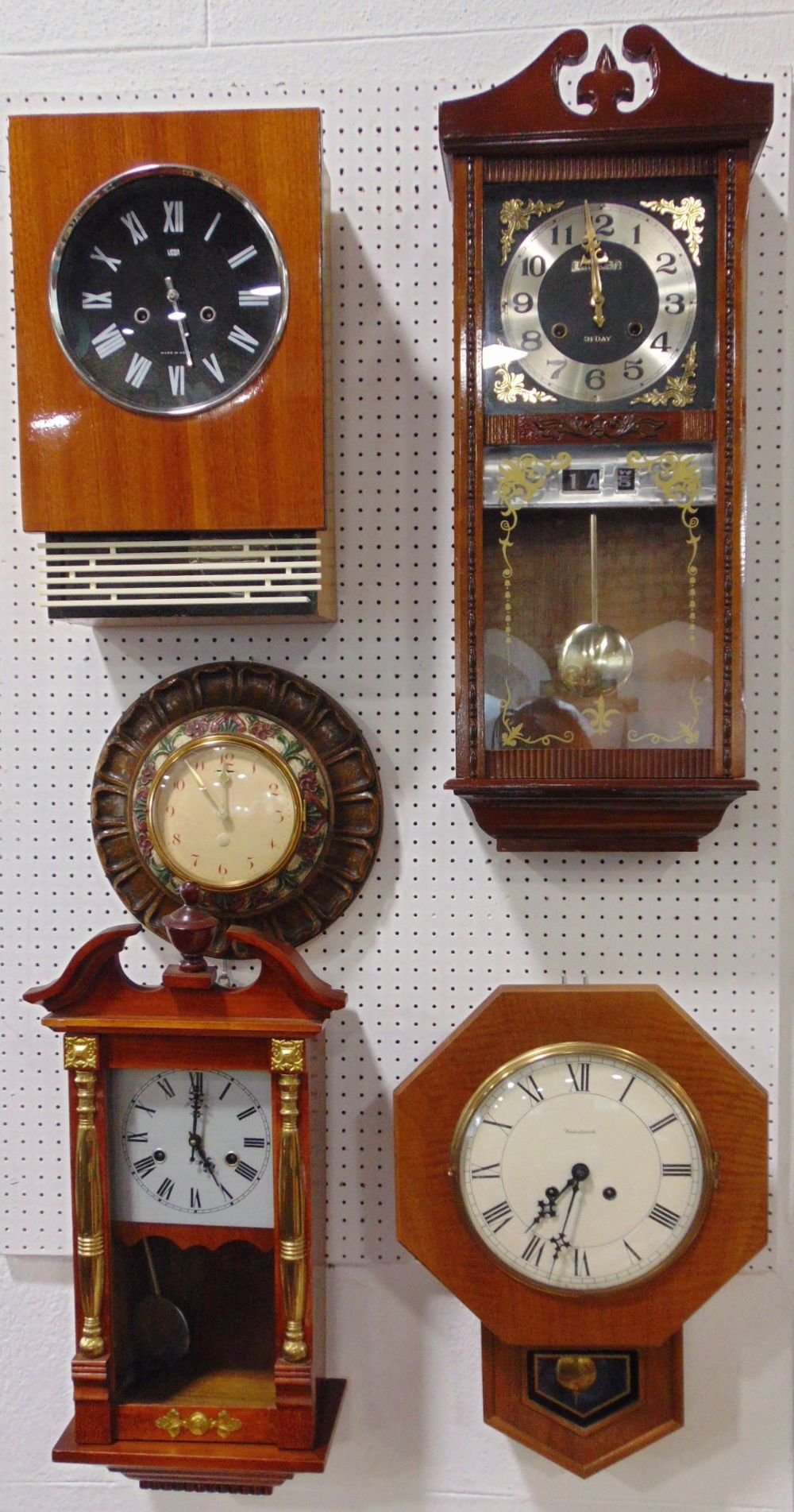 A collection of five various vintage wall clocks to include a 31 day clock with day/date aperture, a