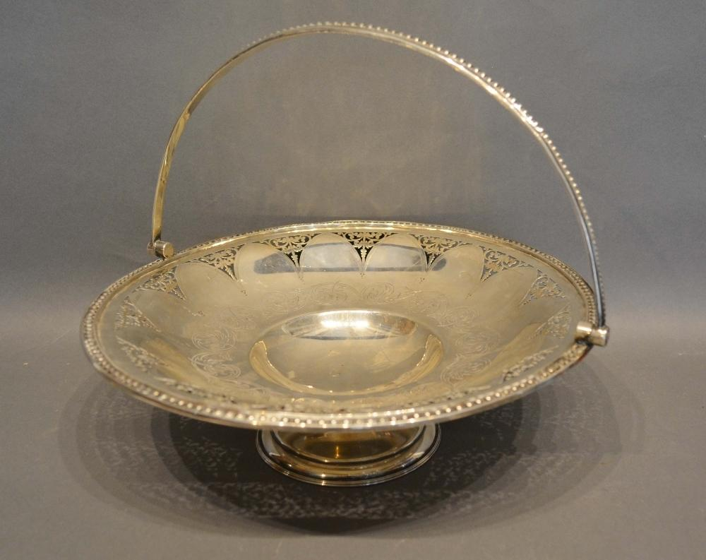 Lot 188 - A Victorian Sheffield Silver Fruit Basket with pierced and engraved decoration upon a shaped