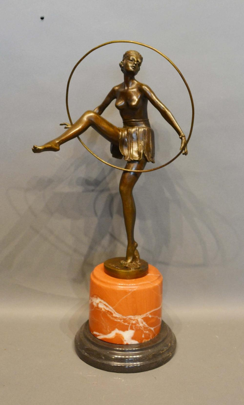 An Art Deco Style Patinated Bronze Model in the Form of a Dancing Girl with Hoop upon variegated
