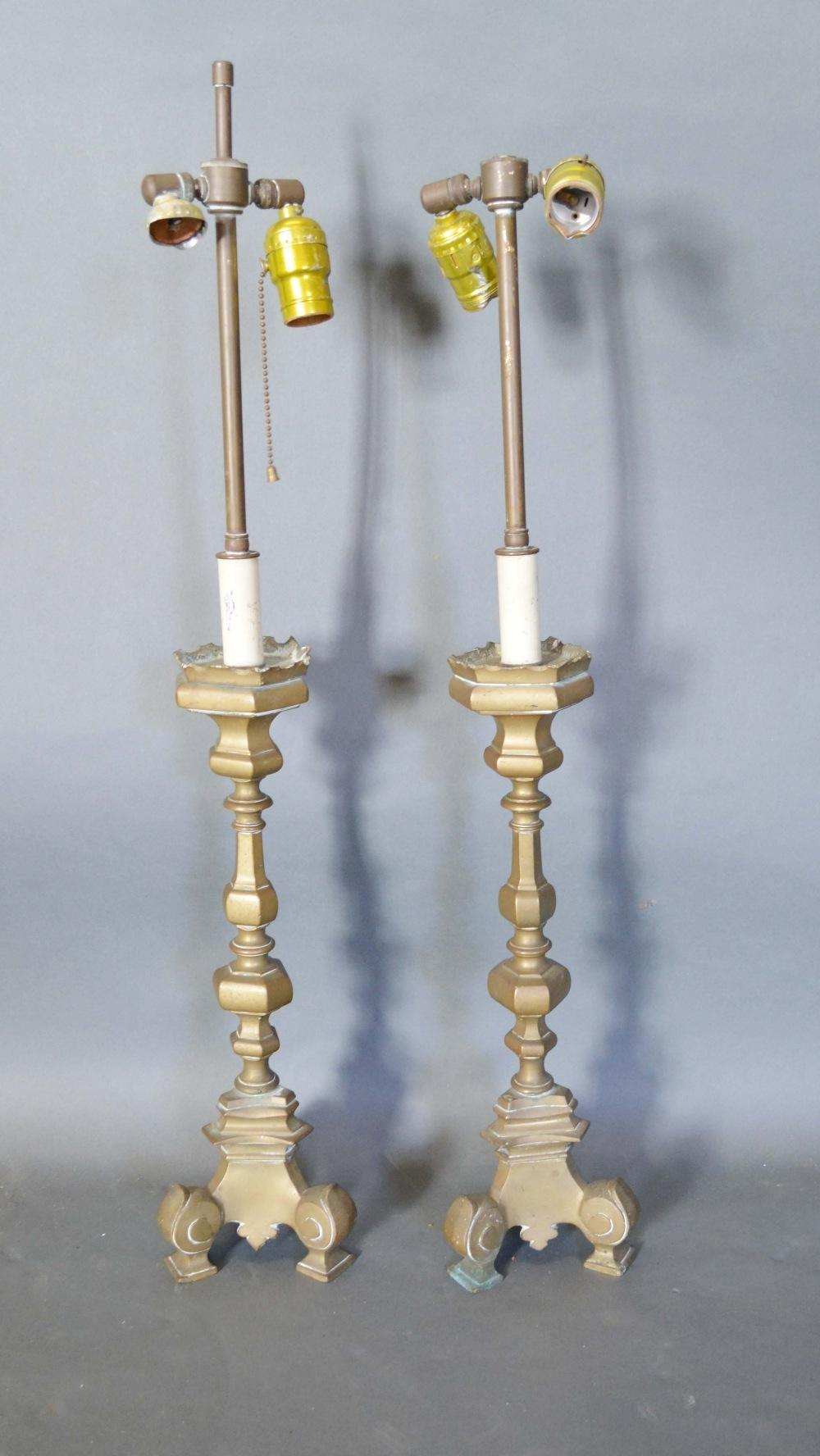 A Pair of 18th Century Style Brass Table Lamps of shaped octagonal form with triform scroll feet,