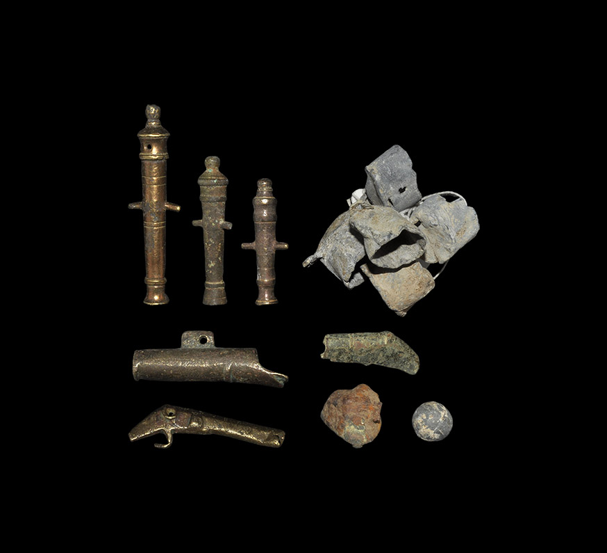 Lot 283 - Post Medieval Toy Cannon and Gun-Related Items Group