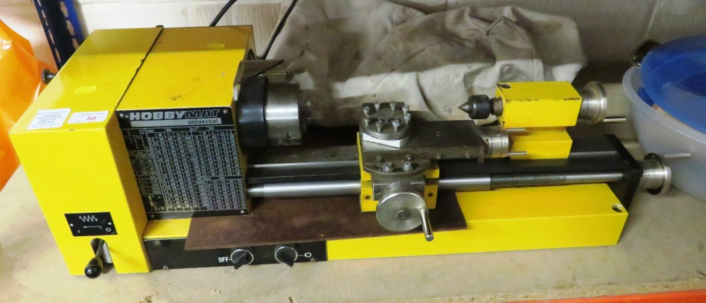 Lot 50 - HOBBYMAT UNIVERSAL LATHE WITH BOX OF ACCESSORIES