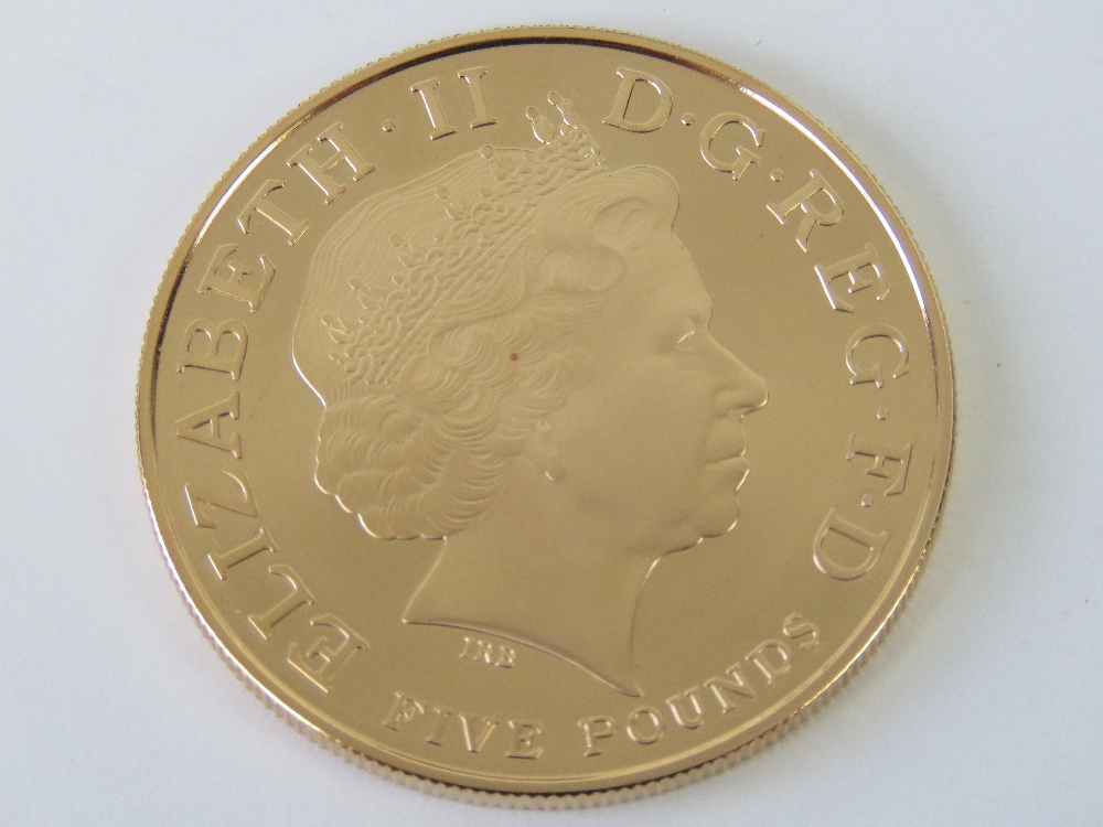 Lot 301 - A 22ct gold proof 2013 'Christening of HRH Prince George' £5 coin, 39.