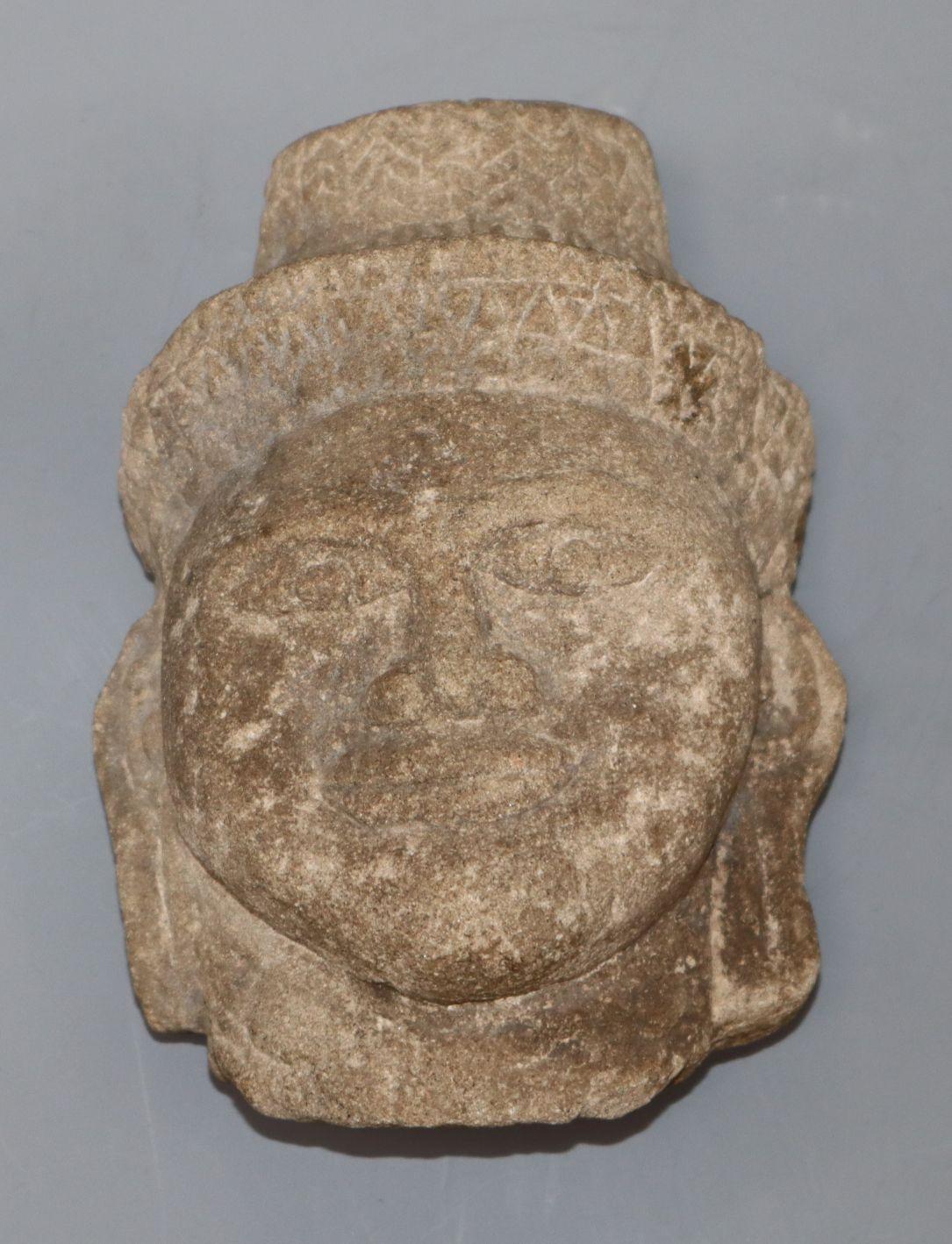 Lot 1093 - A 10 - 12th century Cambodian Khmer sandstone Buddha head height 15cm