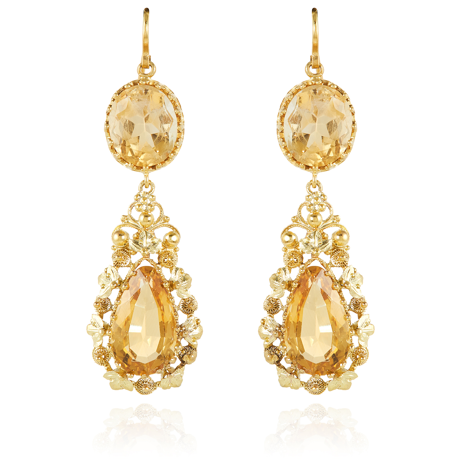 Los 6 - A PAIR OF ANTIQUE CITRINE EARRINGS in high carat yellow gold, each set with an oval cut citrine