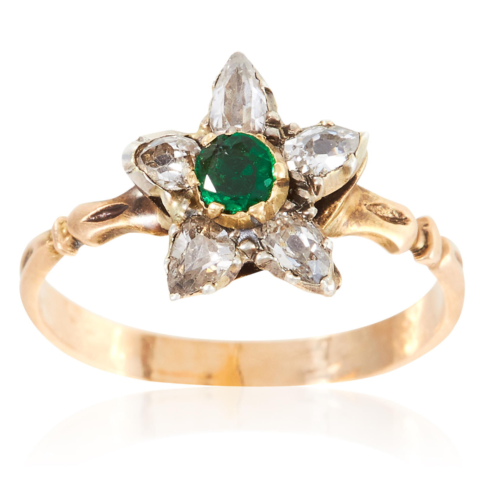 AN ANTIQUE EMERALD AND DIAMOND RING in high carat yellow gold, depicting a flower set with a round