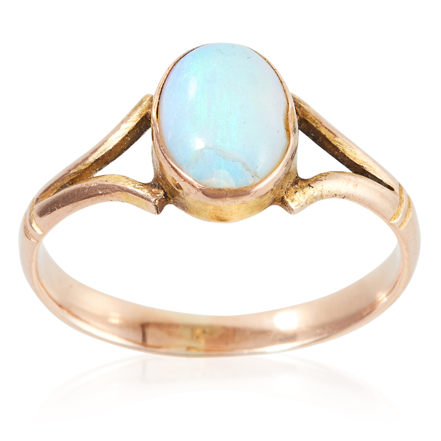 AN OPAL DRESS RING in yellow gold, set with an oval cabochon opal to a bifurcated band, unmarked,