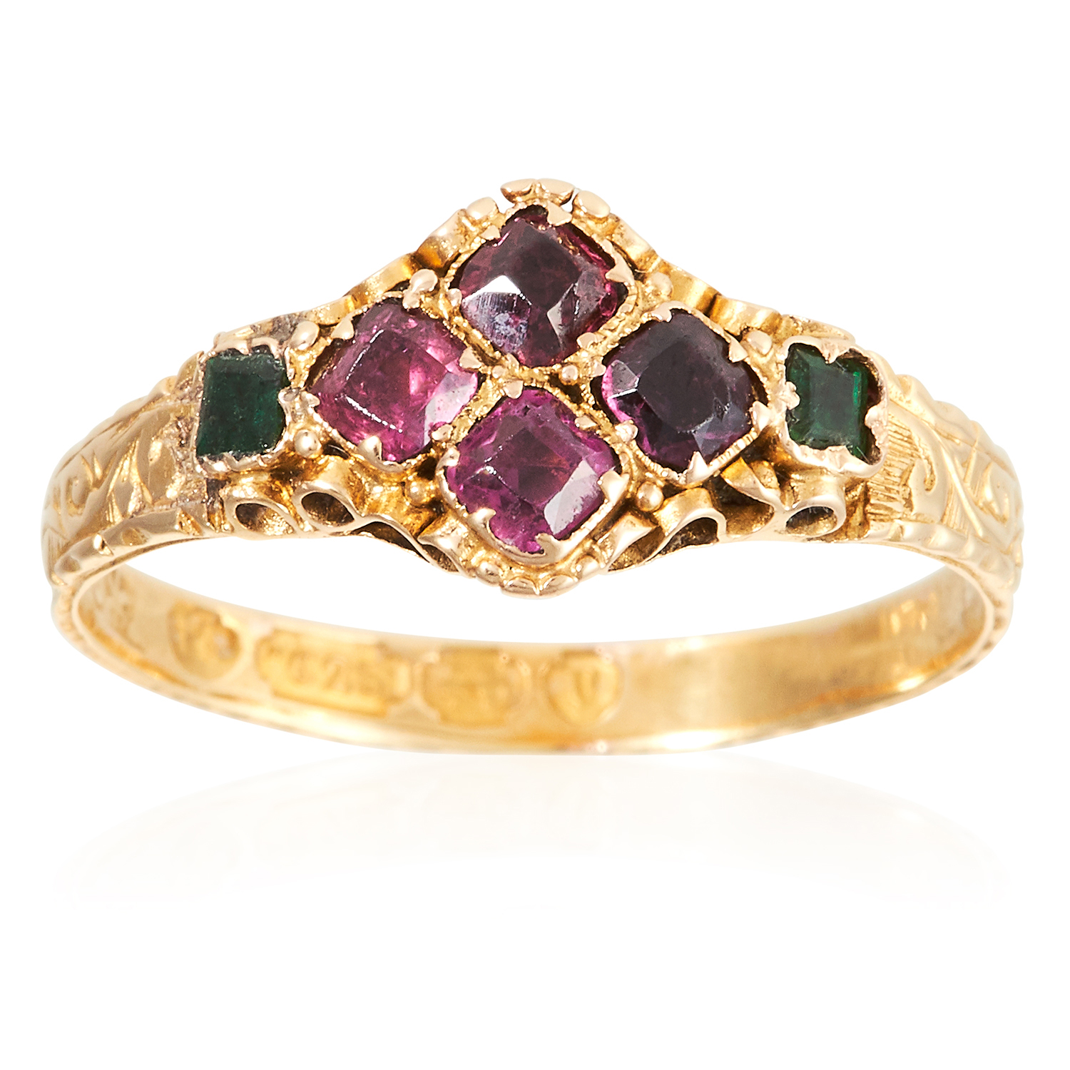 AN ANTIQUE GARNET AND EMERALD RING, CIRCA 1870 in 15 carat yellow gold, set with a quatrefoil